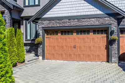 What are the steps to fix auto-reverse on garage door